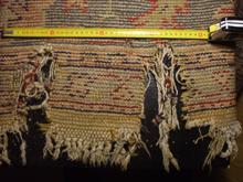 alfombra turca rota antes de restauración