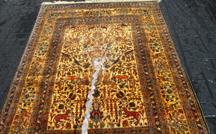 alfombra de pura seda hereke turca inmersion en agua